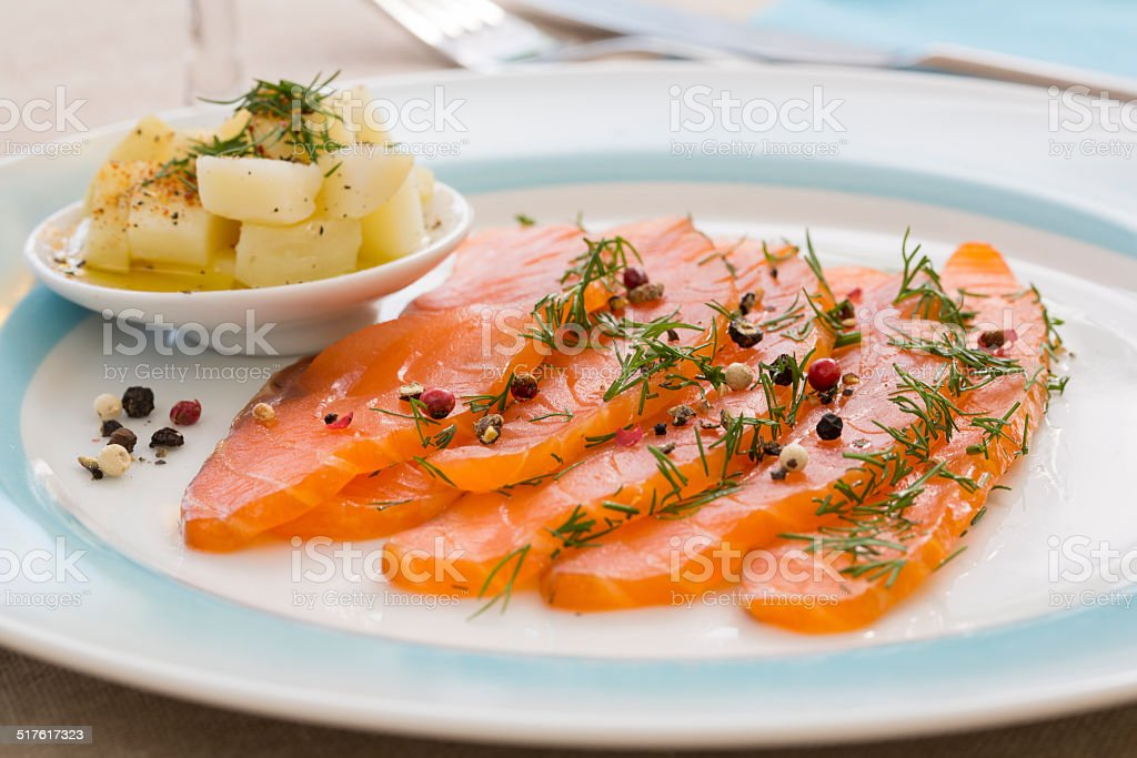 Smoked  salmon and ingredients in plate on table royalty-free stock photo