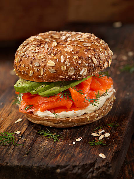 Smoked Salmon Bagel with Cream Cheese and Avocado - Photo
