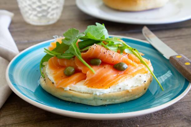 Smoked salmon bagel with cream cheese stock photo