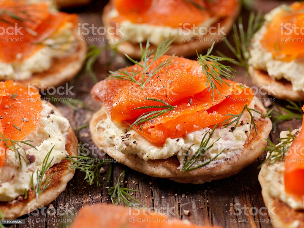 Smoked Salmon Bilini with Avocado Cream Cheese stock photo