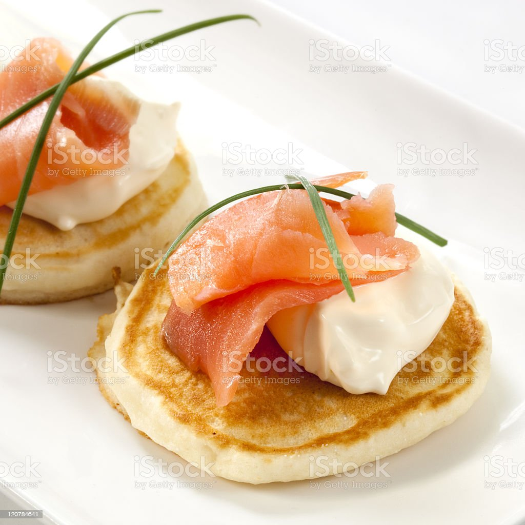 Smoked salmon blini appetizers stock photo