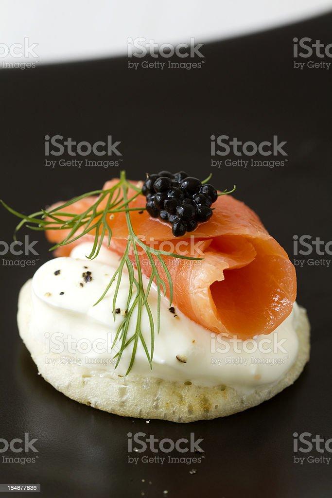 Smoked salmon blini stock photo