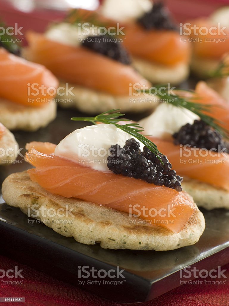 Smoked Salmon Blinis Canapes with Sour Cream and Caviar stock photo