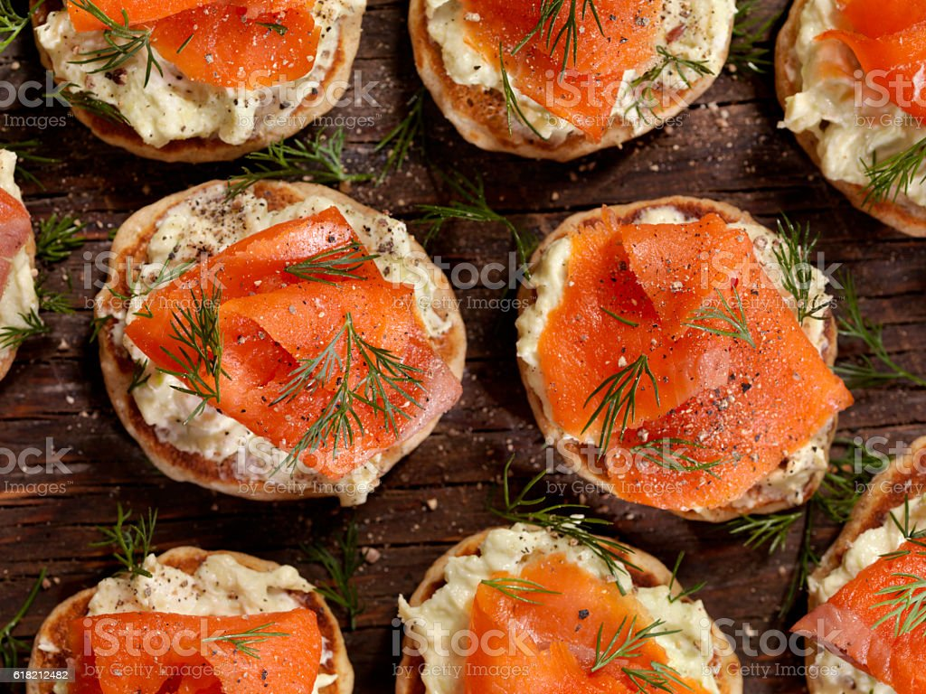 Smoked Salmon Canapes with Avocado Cream Cheese stock photo