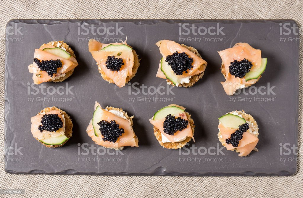 Smoked Salmon Canapes with Sour Cream and Caviar stock photo