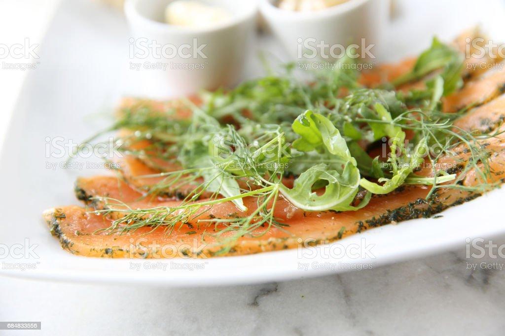 Smoked salmon gravlax with bread stock photo