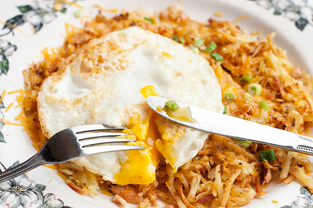 Smoked Salmon Hash with Fried Eggs stock photo