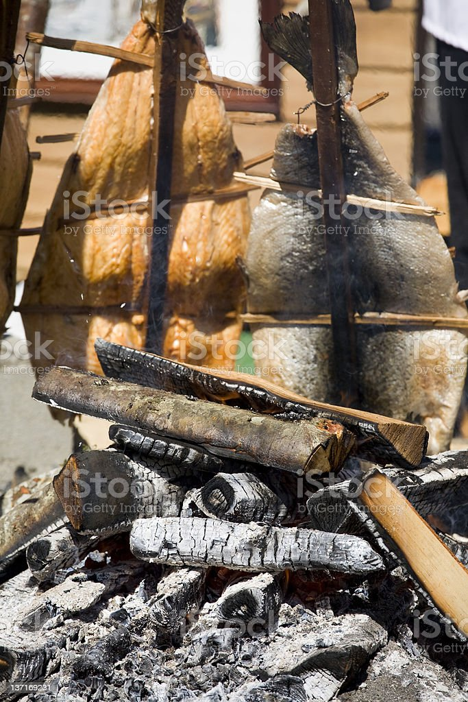 Smoked Salmon on an Open Pit Fire royalty-free stock photo