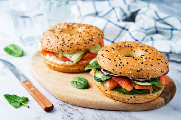 Smoked salmon ricotta cheese cucumber bagel stock photo