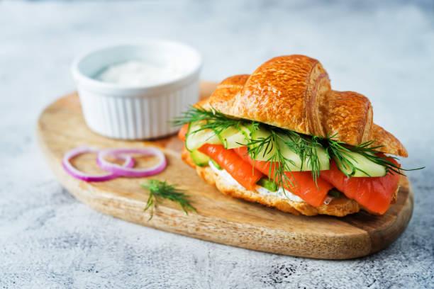 Smoked salmon ricotta cheese cucumber sandwich stock photo