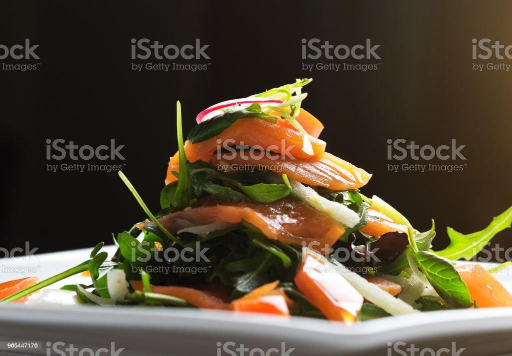 Smoked salmon salad piled up on plate zbiór zdjęć royalty-free
