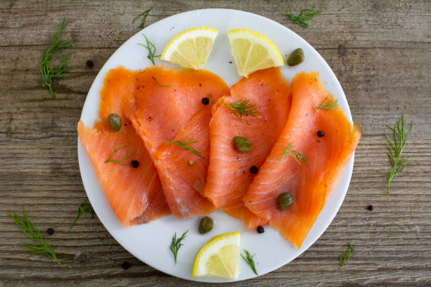 Smoked salmon slices with capers and dill stock photo