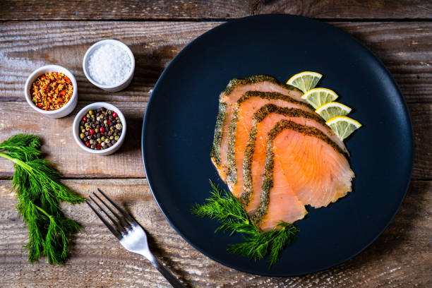 Smoked salmon with dill and lemon stock photo