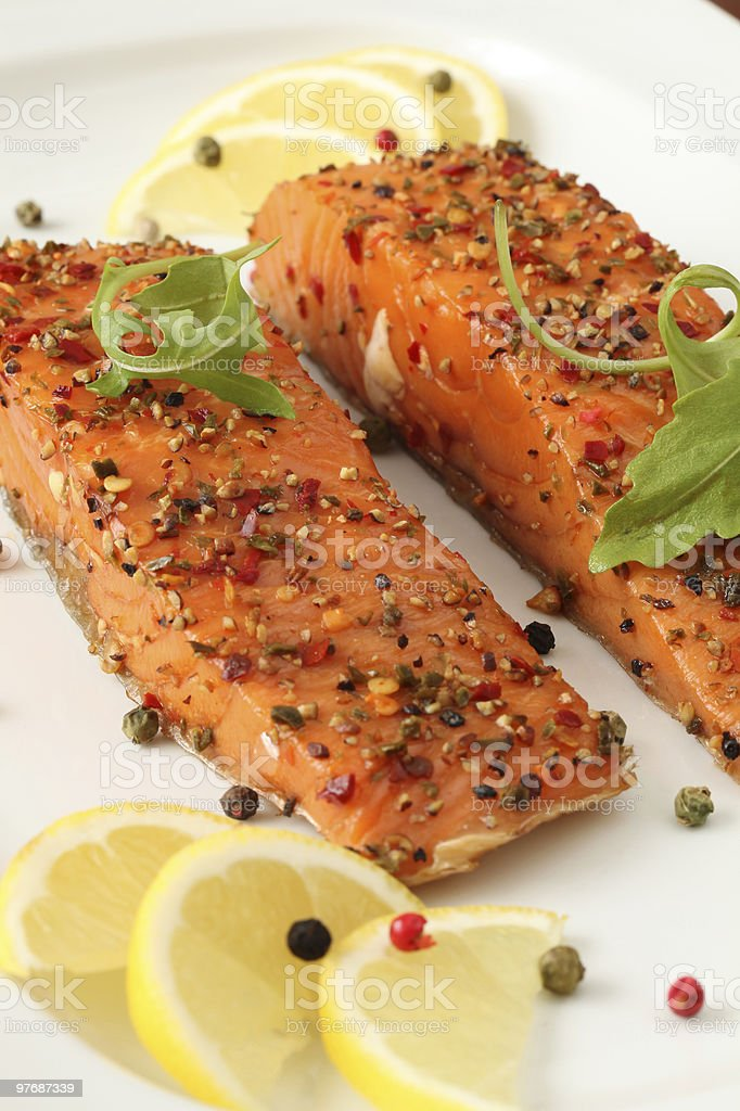 Smoked salmon with pepper on it stock photo