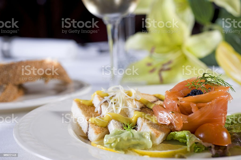 Smoked salmon with toast a la carte appetizer royalty-free stock photo