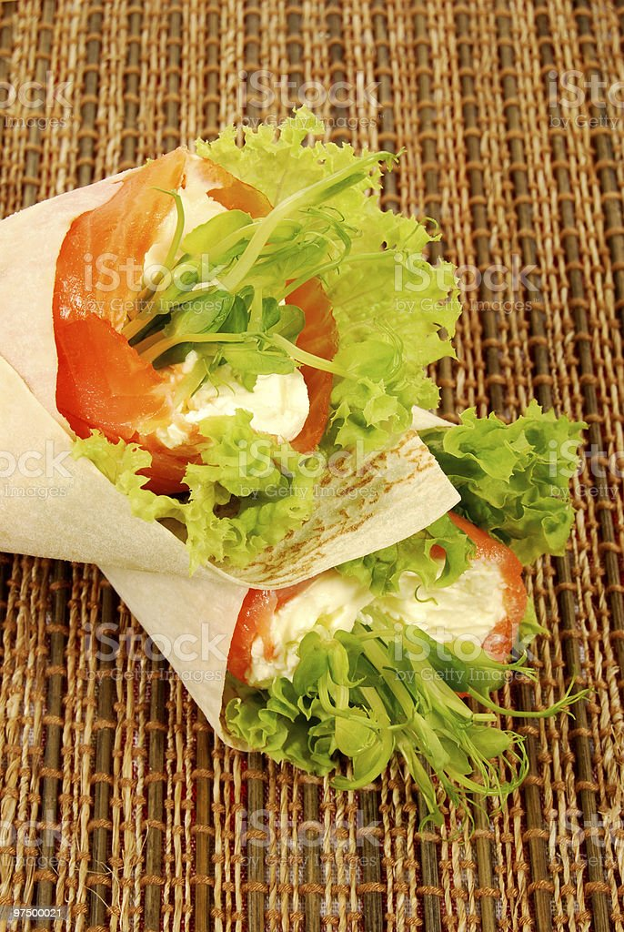 Smoked salmon wrap sandwiches on a bamboo mat royalty-free stock photo