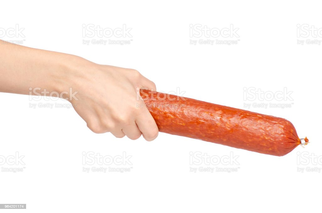 A smoked sausage in hand stock photo