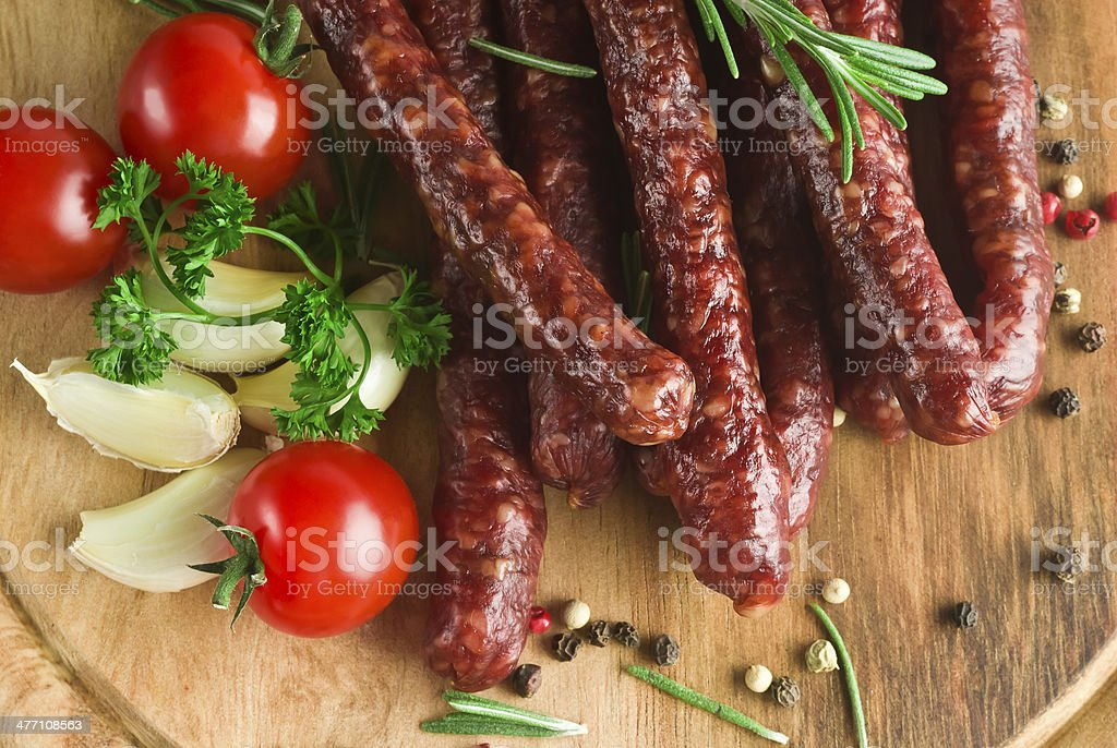 Smoked sausage with rosemary and peppercorns royalty-free stock photo