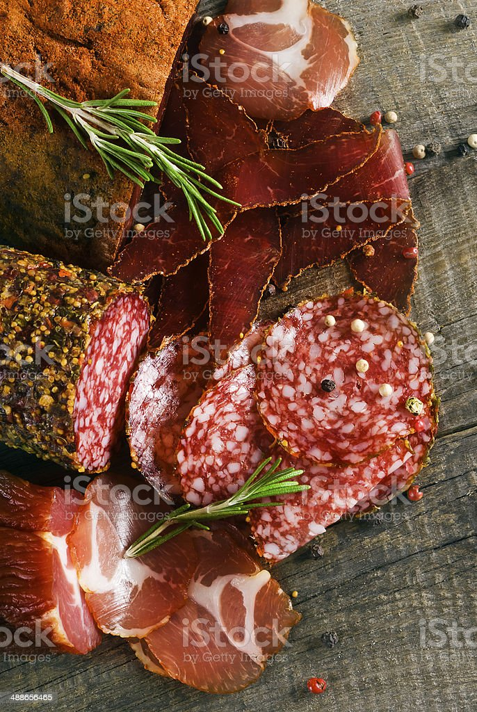 Smoked sausage with rosemary and peppercorns stock photo