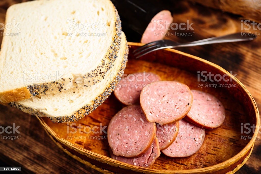 Smoked sausages and bread royalty-free stock photo