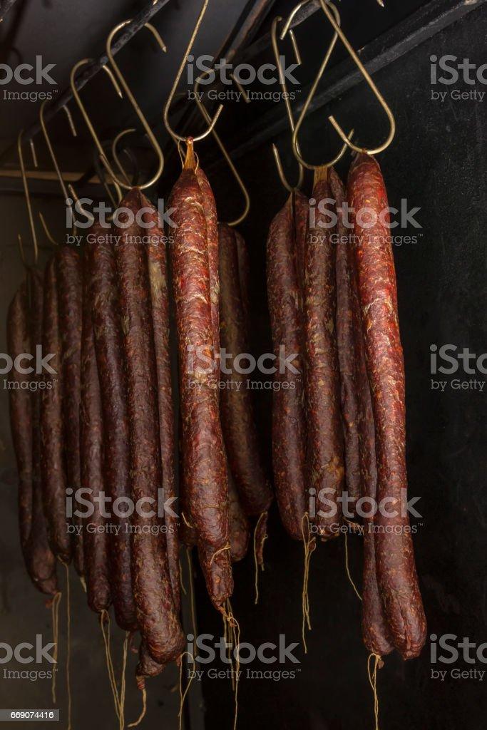 Smoked sausages hanging in smokehouse 2 stock photo