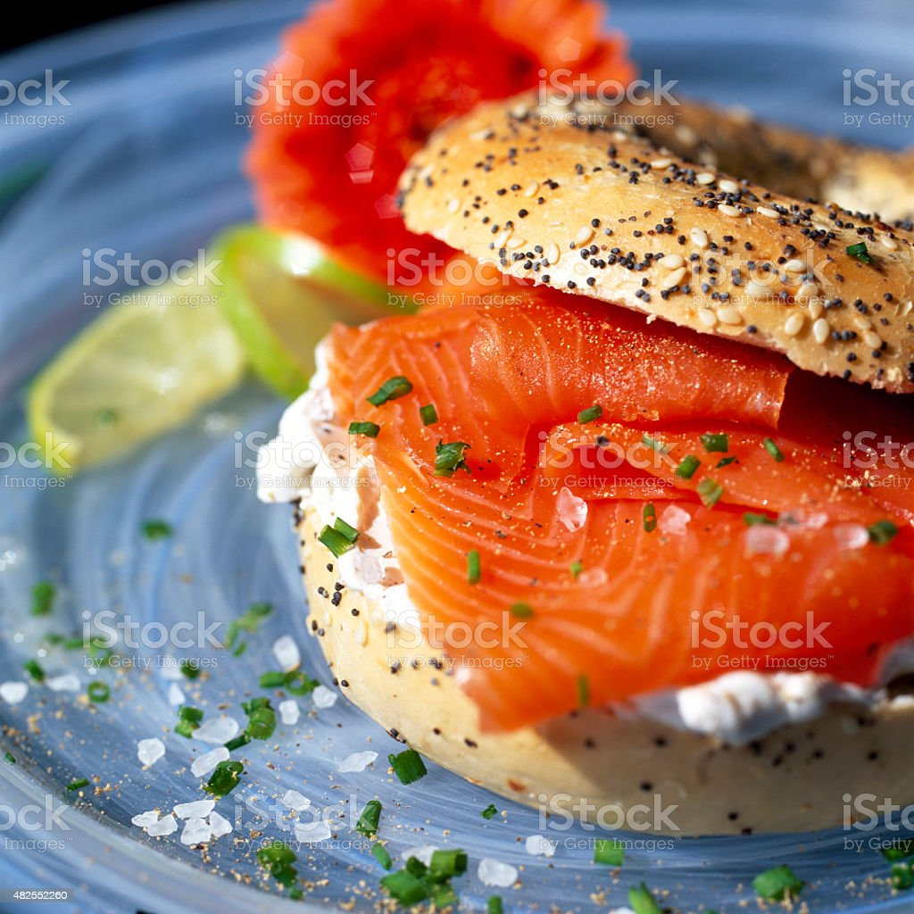Smoked Sliced Salmon With Cream Cheese On a Seeded Bagel stock photo