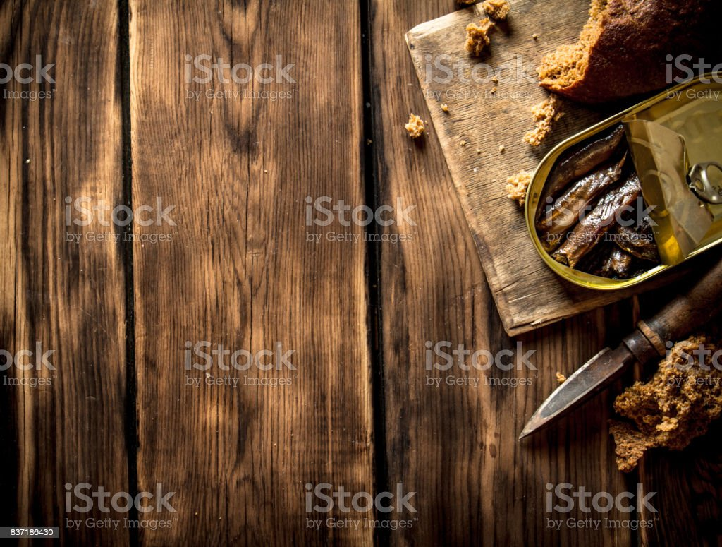 Smoked sprats with rye bread. stock photo