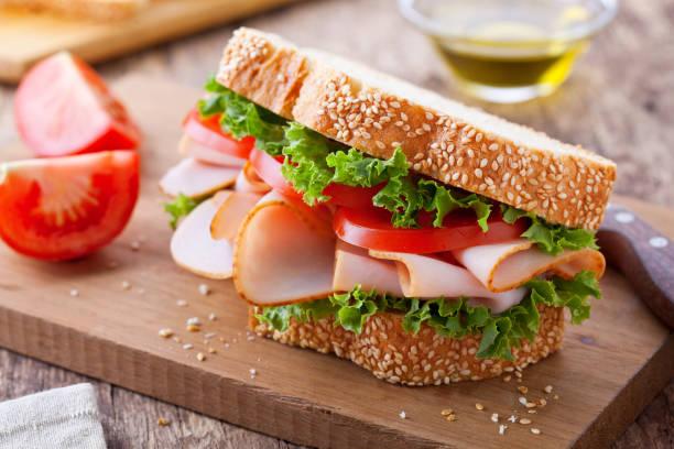 smoked turkey and tomato sandwich - panino ripieno foto e immagini stock