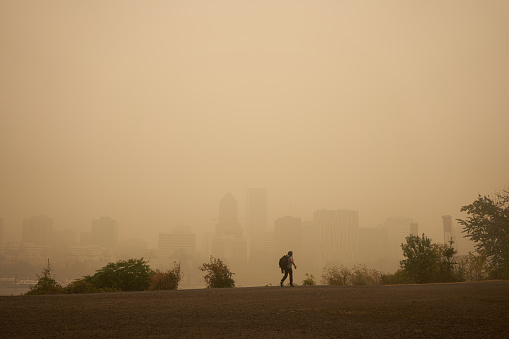 Portland, OR, USA - Sep 12, 2020: An orange smoke-filled sky is seen above Portland's downtown skyline on Saturday afternoon during the Oregon wildfires.