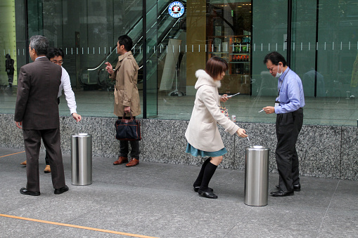Smokers in smoking area in Tokyo.