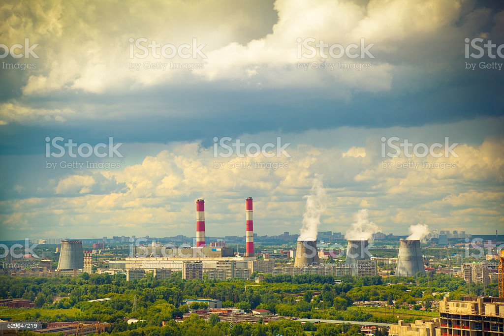 smokestack industrial chimney in the town stock photo