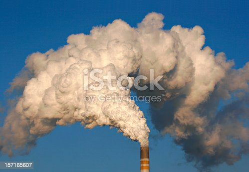 exhaust fumes blown into a blue sky