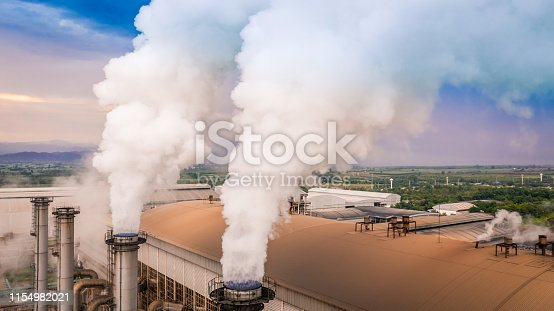 istock Smokestack pipe factory pollution in the city, Fuel Power Plant Smokestacks Emit Carbon Dioxide Pollution. 1154982021