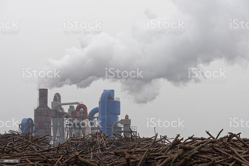 Smokestacks billowing smoke at factory stock photo