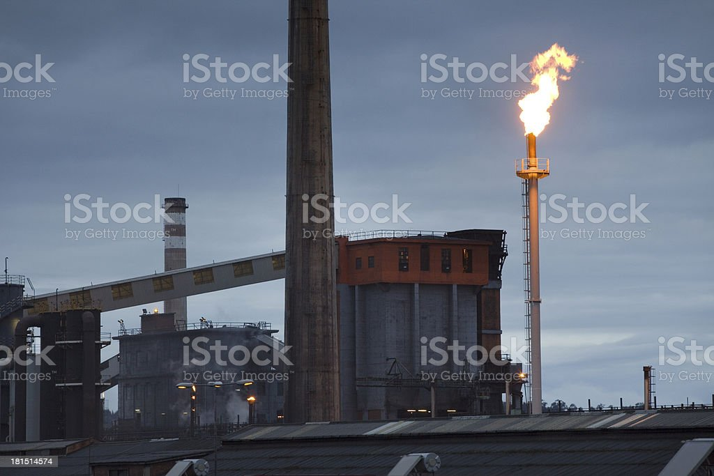 Smokestacks in factory at dawn stock photo