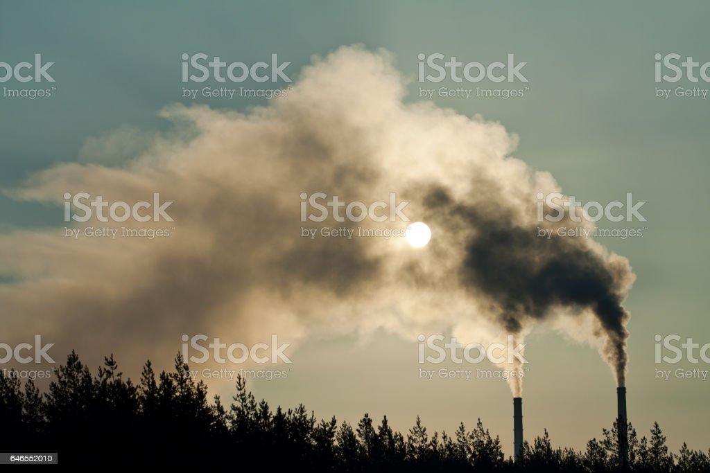 Smokestacks making air pollution stock photo