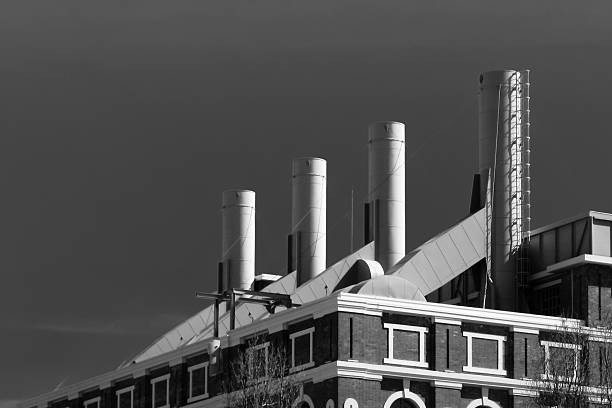 smokestacks - industrial revolution stock pictures, royalty-free photos & images