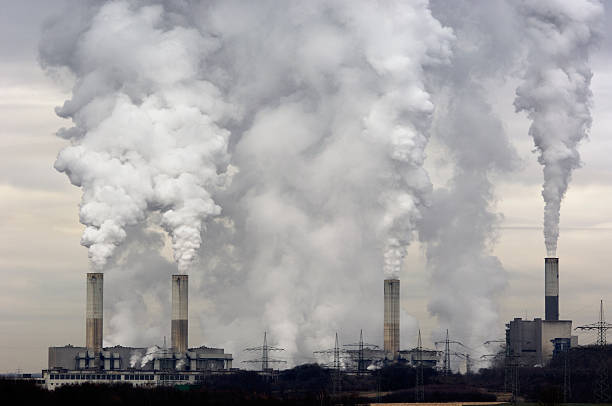 smokestacks with pollution - pollution stock pictures, royalty-free photos & images