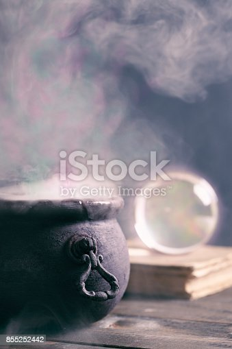 A steaming Halloween cauldron with copy space.