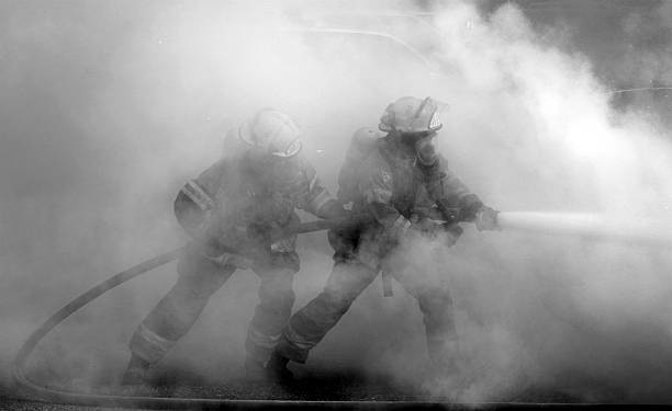 smokin' firemen - firefighter stock photos and pictures