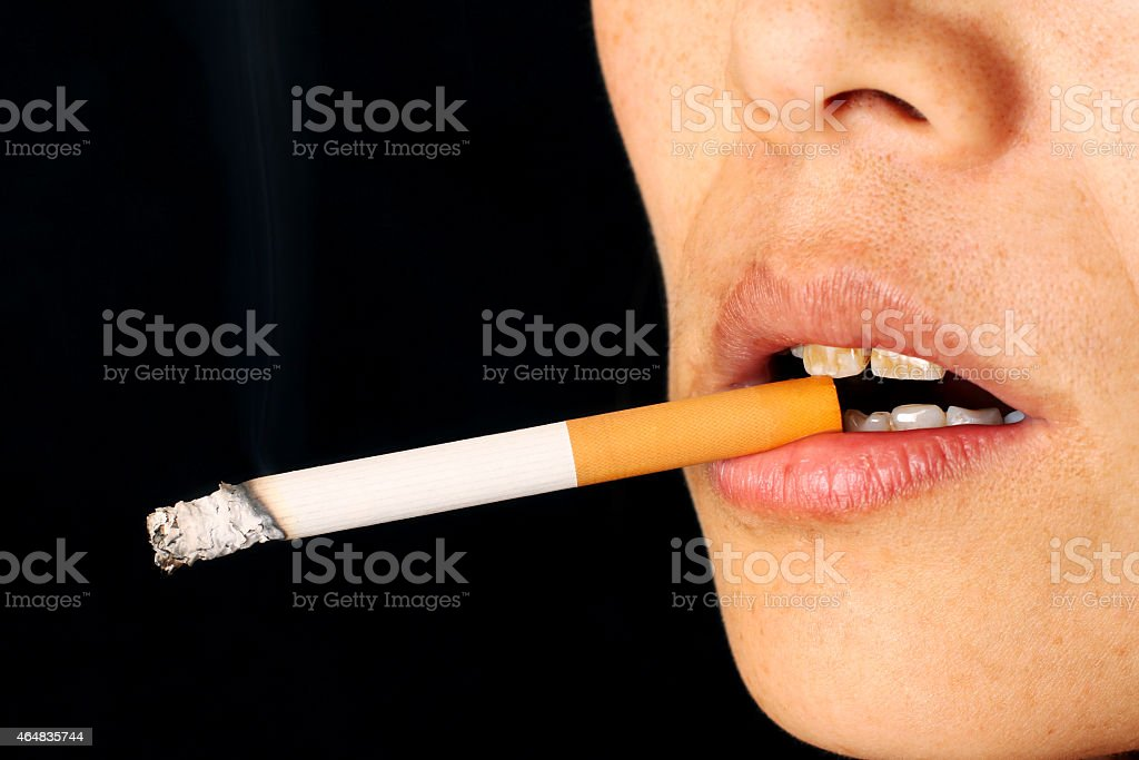 Smoking a Cigarette in close up stock photo