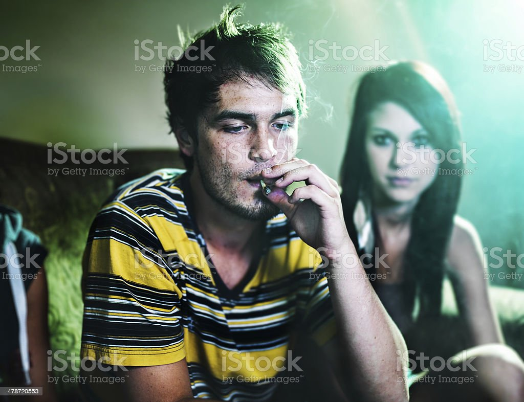 smoking a joint at party stock photo