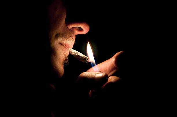 smoking a joint stock photo