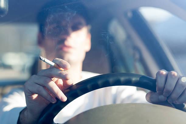 smoking and driving stock photo