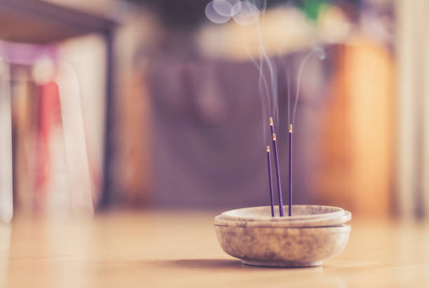 Smoking and smelling joss sticks at home, feng shui; Copy space Joss sticks in smoking bowl are smoking and smelling, home, feng shui; Copy space; incense stock pictures, royalty-free photos & images