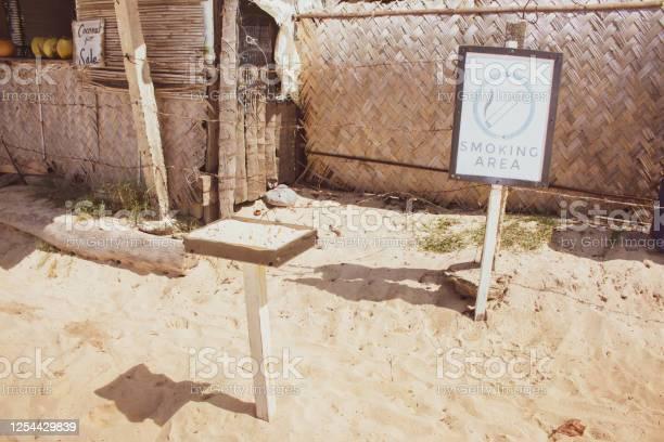 Smoking area on the beach with nameplate with text smoking area and picture id1254429839?b=1&k=6&m=1254429839&s=612x612&h=kztxweratpsdj3uxrlsg60 5ywtyyiaejrvsdf nxgi=