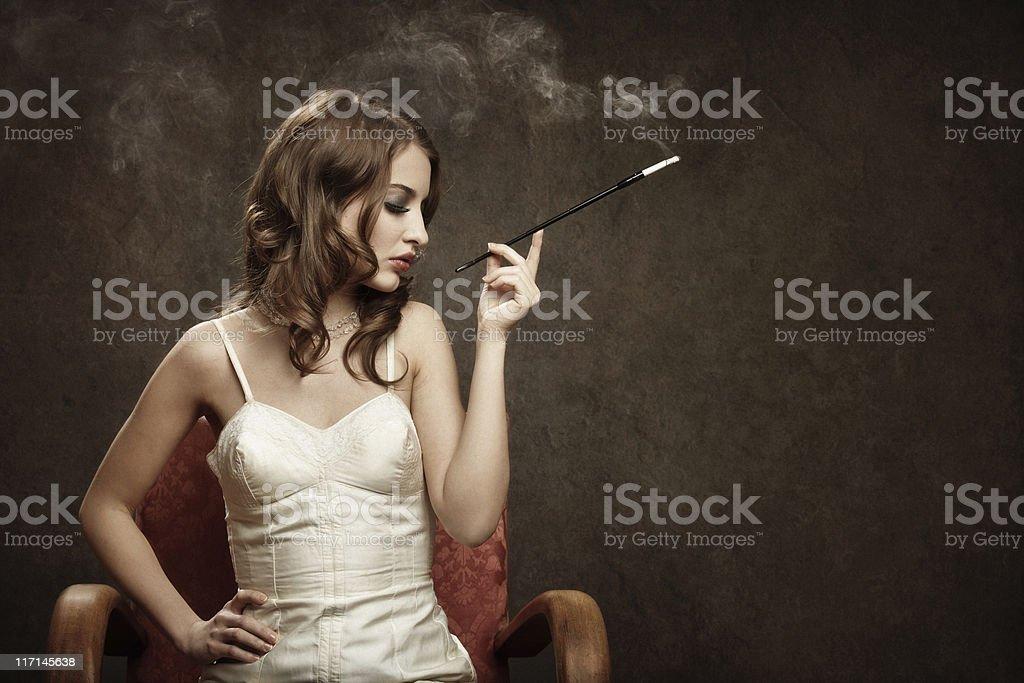 smoking bad girl - vintage style stock photo