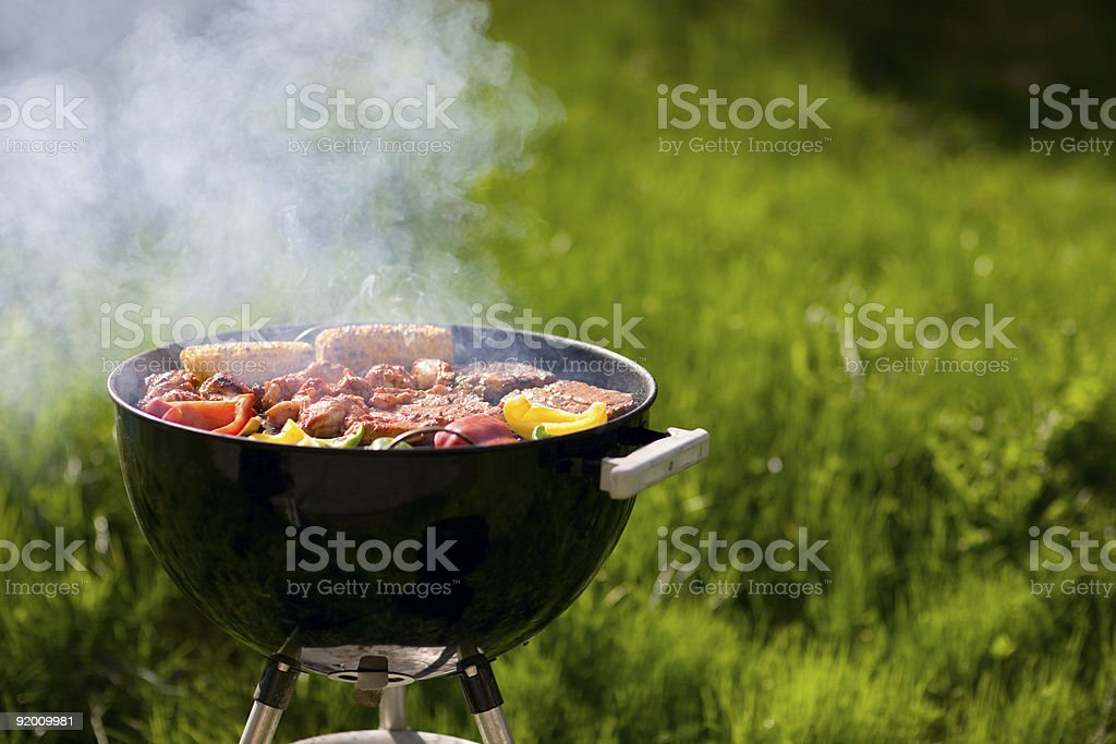 Smoking barbecue cooking meat and vegetables stock photo