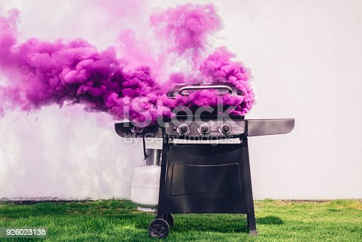 Purple smoke coming out of portable barbecue grill