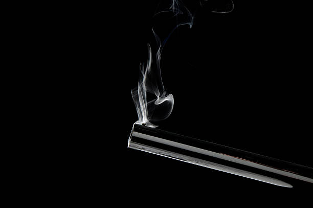 Smoking Barrel of a Gun stock photo